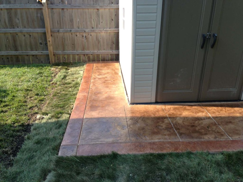 Stamped walkway around a shed